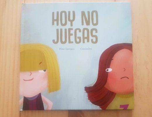 portada del cuento Hoy no juegas, con la imagen de dos niñas, una triste y la otra con sonrisa malvada