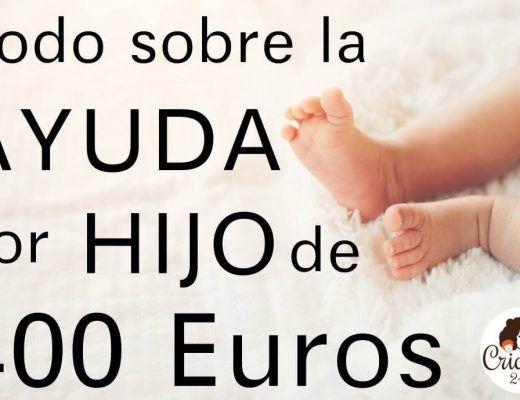 foto de las piernas de un bebé y el texto: todo sobre la ayuda por hijo de 400 euros. Logo de Criando 24/7